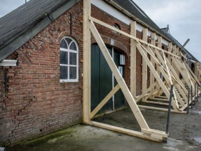 Building in northern Netherlands reinforced with wood beams to protect from earthquake damage.
